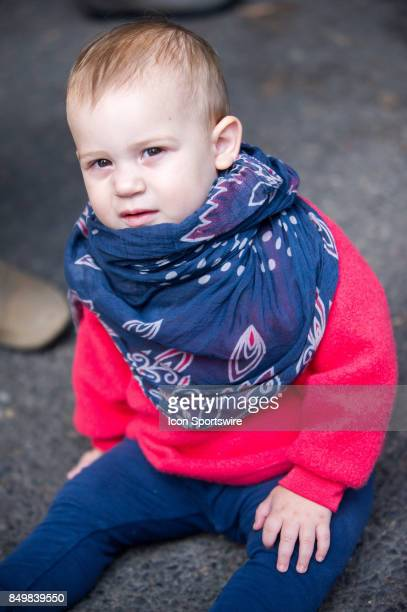 A child is part of demonstrators gathered outside of the US Citizenship and Immigration Services building in Portland to protest Attorney General...