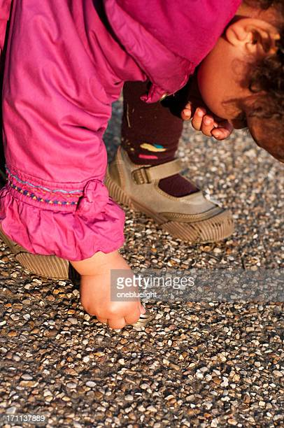 Child is picking money from floor
