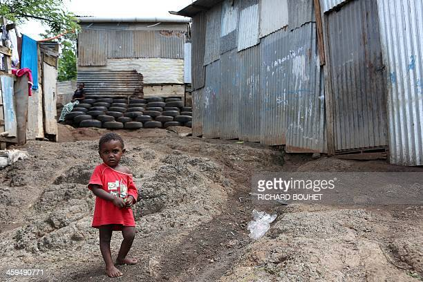 A child is pictured in a slum of the impoverished neighborhood of Tsountzou on March 27 2013 in Mamoudzou in the French overseas Indian Ocean...