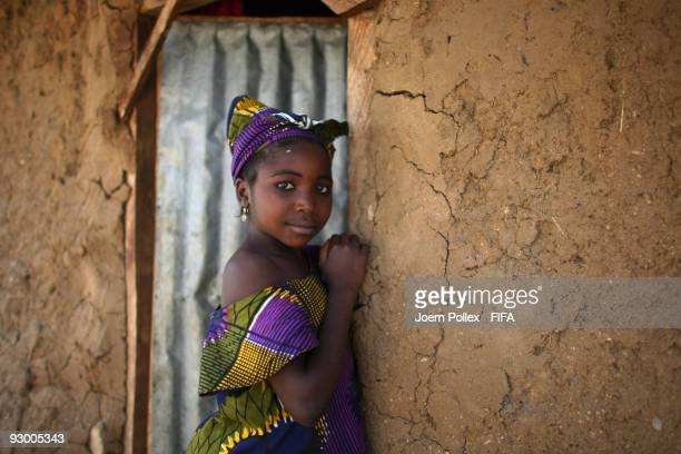 A child is pictured in the door way of her mud and brick home on November 07 2009 in Bauchi Nigeria
