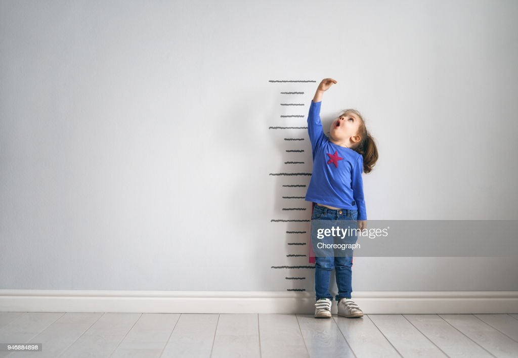 child is playing superhero : Stock Photo