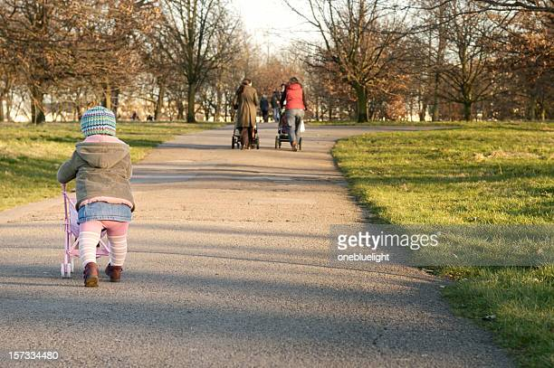 Child is pushing pushchair