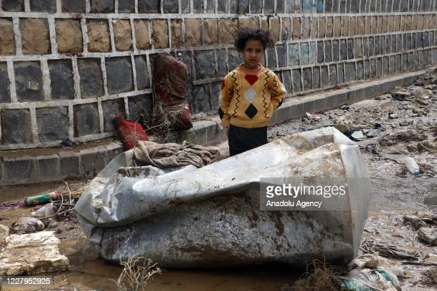 Child is seen amid muds on damaged streets hit by a flood due to heavy rain in Sanaa, Yemen on August 07, 2020. In the capital city Sanaa, avenues...