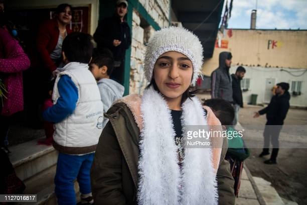 A child is seen in the refugee camp in Lavrio Greece on February 9 2019 A woman from northern Greece made scarfs and beanies for the children from...