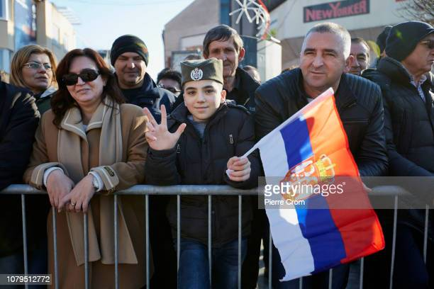 A child is seen making the Serbian three finger sign during the parade in Banja Luka on January 9 2019 in Banja Luka Bosnia and Herzegovina Republika...