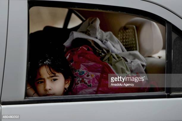 A child is seen on the car while passing the control point of peshmargas of Iraq Kurdistan Regional Government on the outskirts of Mosul Iraq on 12...