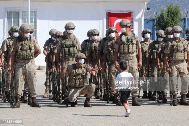 Child is seen to farewell his father as Turkish soldiers are seen during the farewell ceremony ahead of going for their duty in Jarabulus district of...
