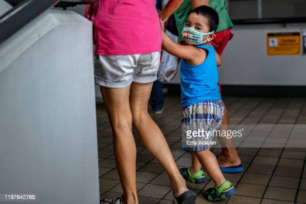 A child is seen wearing a face mask as public fear over China's Wuhan Coronavirus grows on January 31 2020 in Manila Philippines The Philippine...