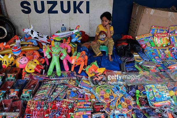 SELATPANJANG RIAU INDONESIA A child is selling a wide variety of children's toys in the yard of a motorcycle shop in Selatpanjang Riau