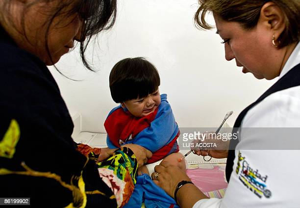 A child is vaccinated with a hepatitis B vaccine at the Mixcoac health center in Mexico city on April 24 2009 AFP PHOTO / Luis Acosta