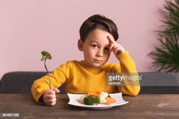 Child is very unhappy with having to eat vegetables.