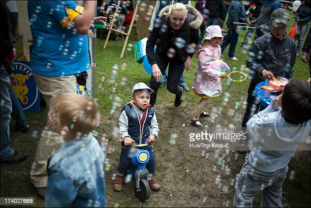 Child is wondering about bubbles in Budapest, on children' day.