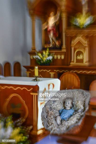 child jesus near the altar in a church in ilha grande - radicella stock photos and pictures
