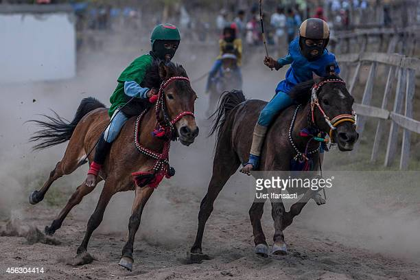 Child jockeys compete during the traditional horse races as part of Moyo festival on September 27 2014 in Sumbawa Island West Nusa Tenggara Indonesia...