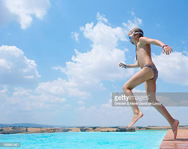 child jumping in pool in stunning scenery - bikini bottom stock pictures, royalty-free photos & images