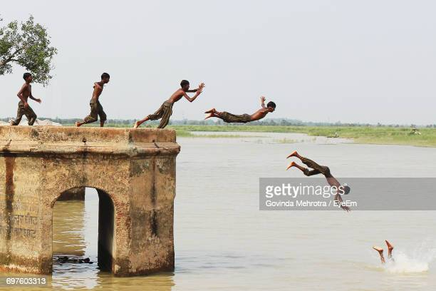 Child Jumping In River