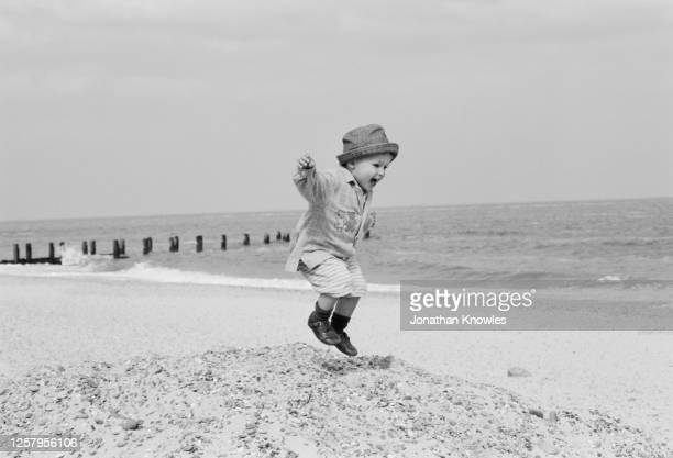 child jumping on sand - 1999 stock pictures, royalty-free photos & images