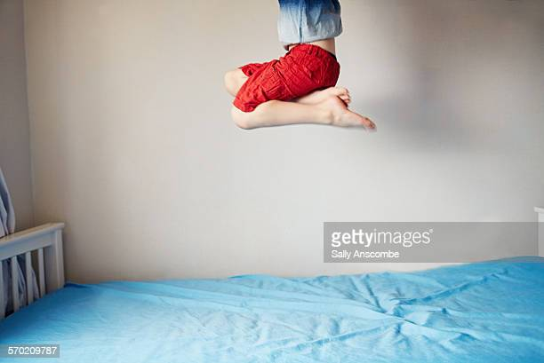 Child jumping on the bed