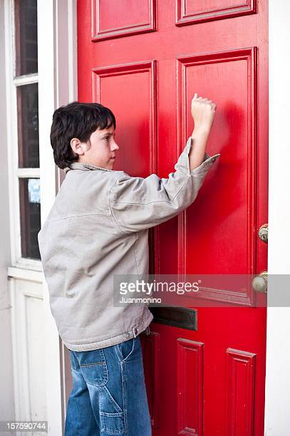 child knocking a door - knocking on door stock photos and pictures