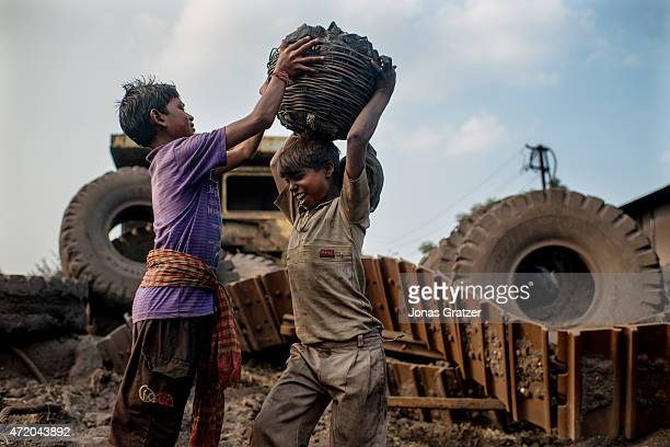 Child laborer working at a coal mine in Jharia. Jharia in India's eastern Jharkand state is literally in flames. This is due to the open cast coal...