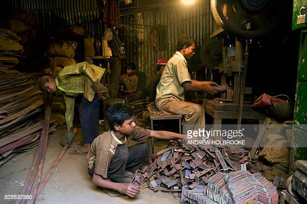 Child laborers work in a metal stamping factory where they make parts to be used in building construction Children in these metal factories earn 1200...