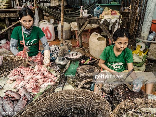 Child labour in a market in Siem Reap Cambodia