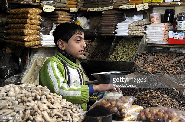 A child labour sells things at Salt Bazaar in capital Sanaa Yemen on January 22 2017 The civil war caused increase in the number of child labourers...