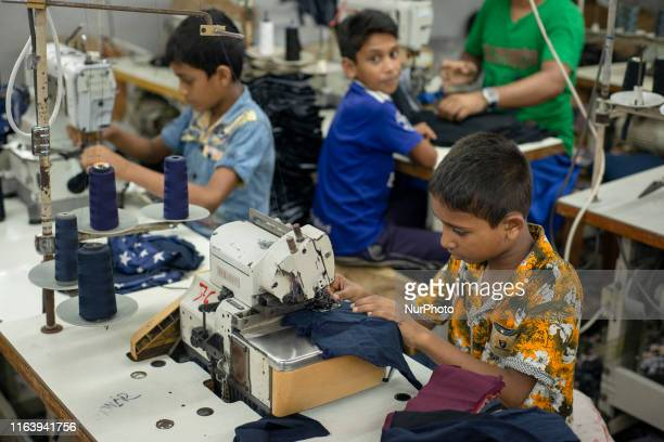 Child labours working with machines in swing sector in a local garments factory at Narayanganj, Bangladesh on August 25, 2019.