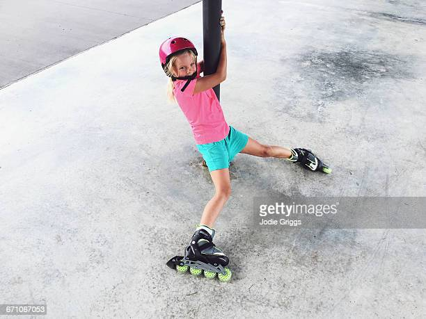 Child learning how to ride inline skates