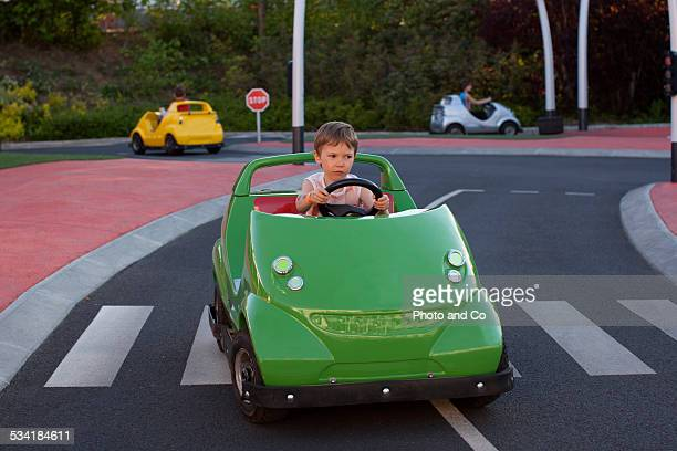 child learning to drive a car