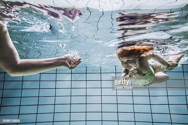 Child learning to swim.