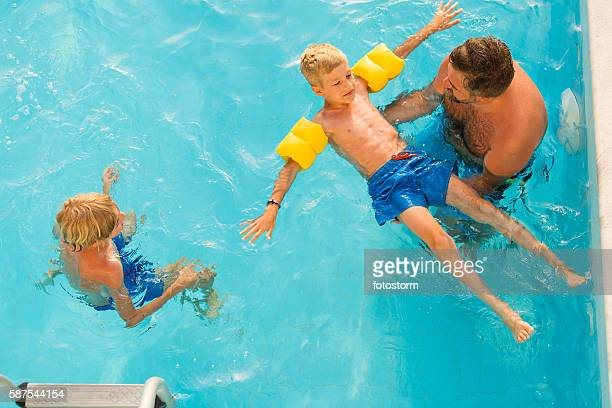 child learning to swim - arm band stock pictures, royalty-free photos & images