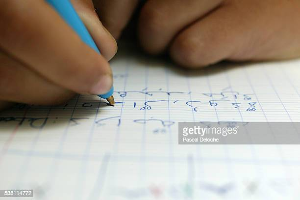 Child Learning to Write in Arabic