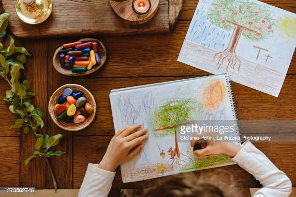 child learning to write the letter t as tree - nature alphabet letters stock pictures, royalty-free photos & images