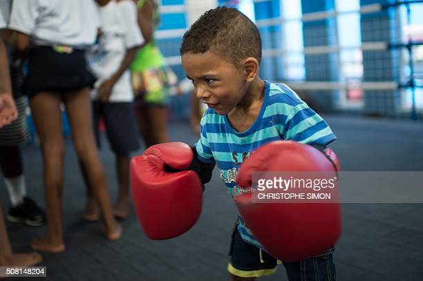 A child learns boxing at the Fight for Peace NGO in the Mare favela in Rio de Janeiro Brazil on January 25 2016 AFP PHOTO / CHRISTOPHE SIMON / AFP /...