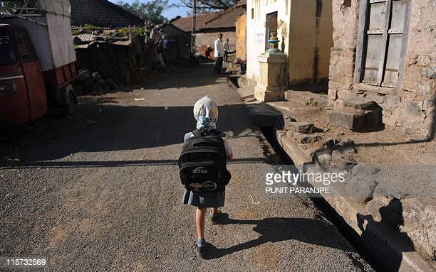 A child leaves for school in Shendurjane village near the town of Wai in Satara district about 250 kilometres from Mumbai on January 11 2011 AFP...