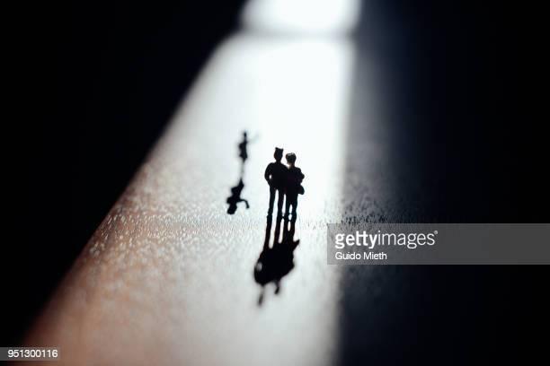 Child leaving parents in sunlight