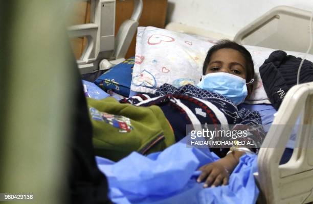 A child lies in a bed at the children's cancer hospital in the southern Iraqi city of Basra on December 19 2017
