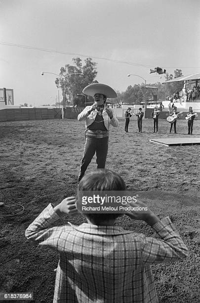 Child Listening to Mariachi Band at Rodeo
