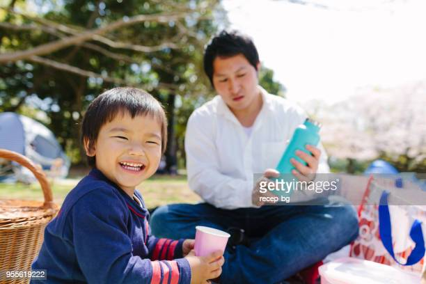child looking at camera happily - hanami stock pictures, royalty-free photos & images