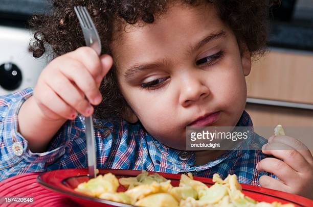 Child looking bored with her plate