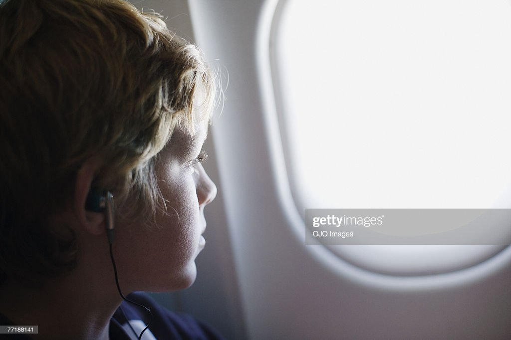 A child looking out his airplane window : Stock Photo