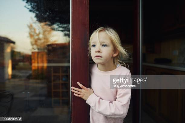 Child looking out into the garden