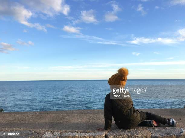 Child looking out over the sea