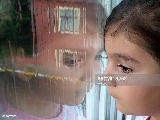 child looking out window - fat girls stock photos and pictures