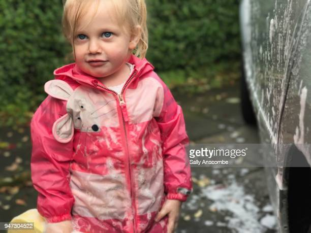 Child looking past the camera in waterproofs
