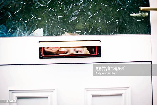 Child looking through letterbox