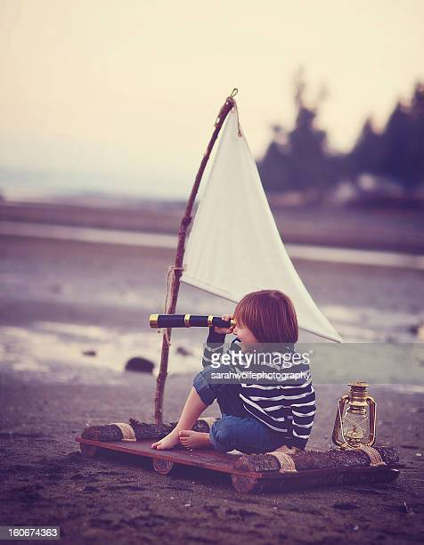 child looking through telescope on a raft