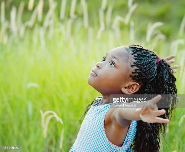 Child Looking Up At A Big World