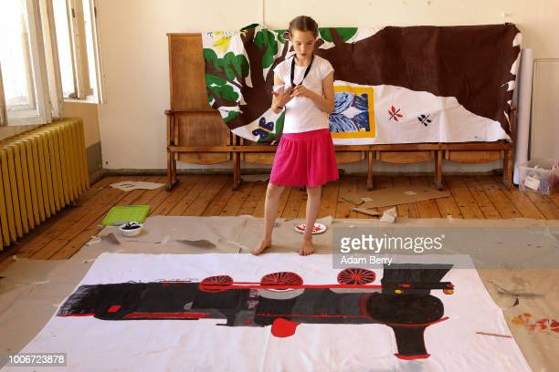 Child looks at a backdrop for her upcoming children's workshop performance during Yiddish Summer Weimar, on July 27, 2018 in Weimar, Germany. The...